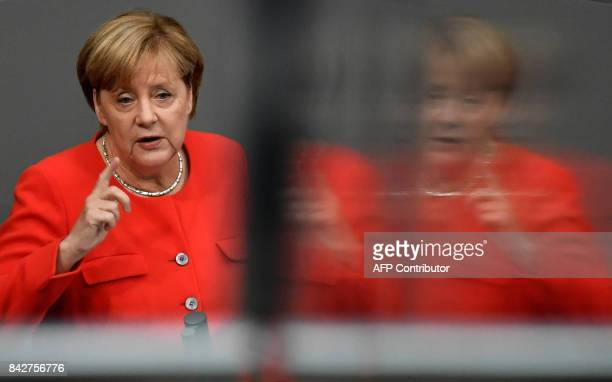 German Chancellor Angela Merkel gives a speech at the Bundestag in Berlin on September 5 2017 Merkel and other top officials debate the state of the...