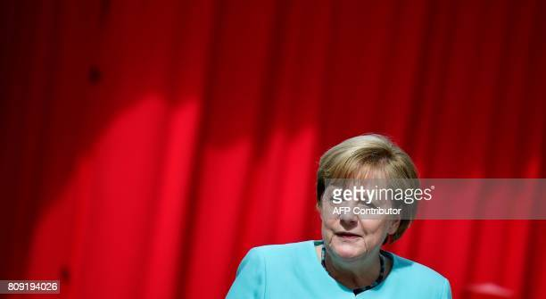 German Chancellor Angela Merkel gives a speech on July 5 2017 during an official welcoming ceremony for two panda bears at the Zoologischer Garten...