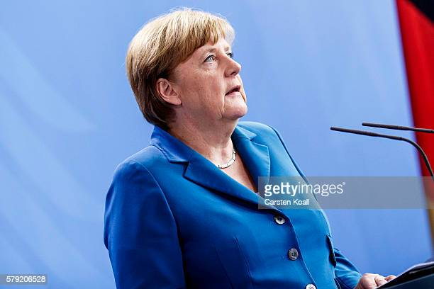 German Chancellor Angela Merkel gives a statement following the shootings in Munich on July 23 2016 in Berlin Germany According to police ten people...