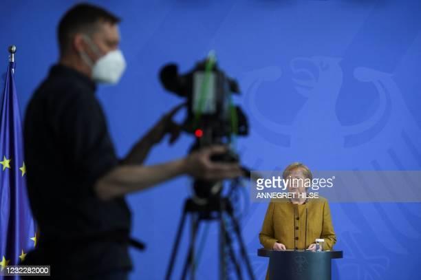 German Chancellor Angela Merkel gives a statement in Berlin, on April 13, 2021 amid the novel coronavirus COVID-19 pandemic.