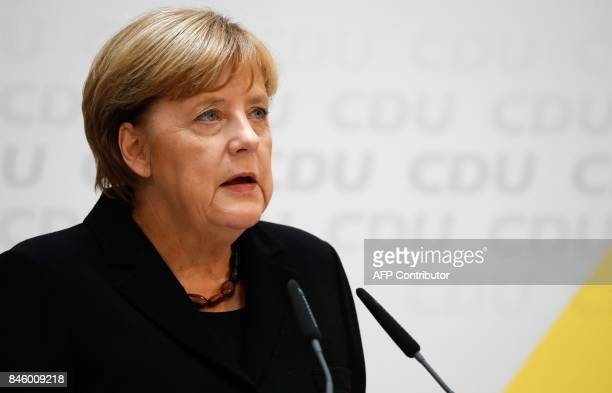 German Chancellor Angela Merkel gives a statement on September 12 2017 in Berlin to express her grief over the death of party colleague Heiner...