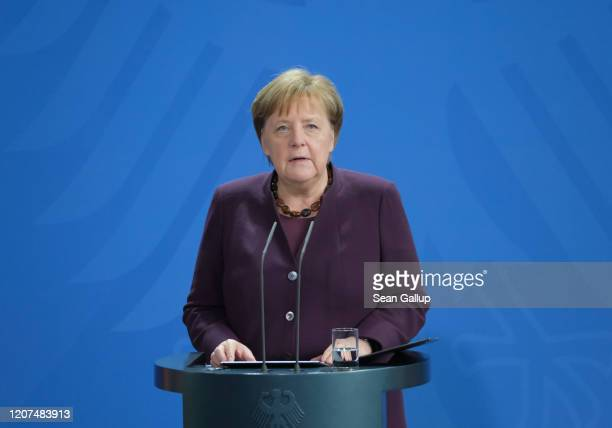 German Chancellor Angela Merkel gives a statement to the media at the Chancellery following yesterday evening's shooting in Hanau on February 20,...