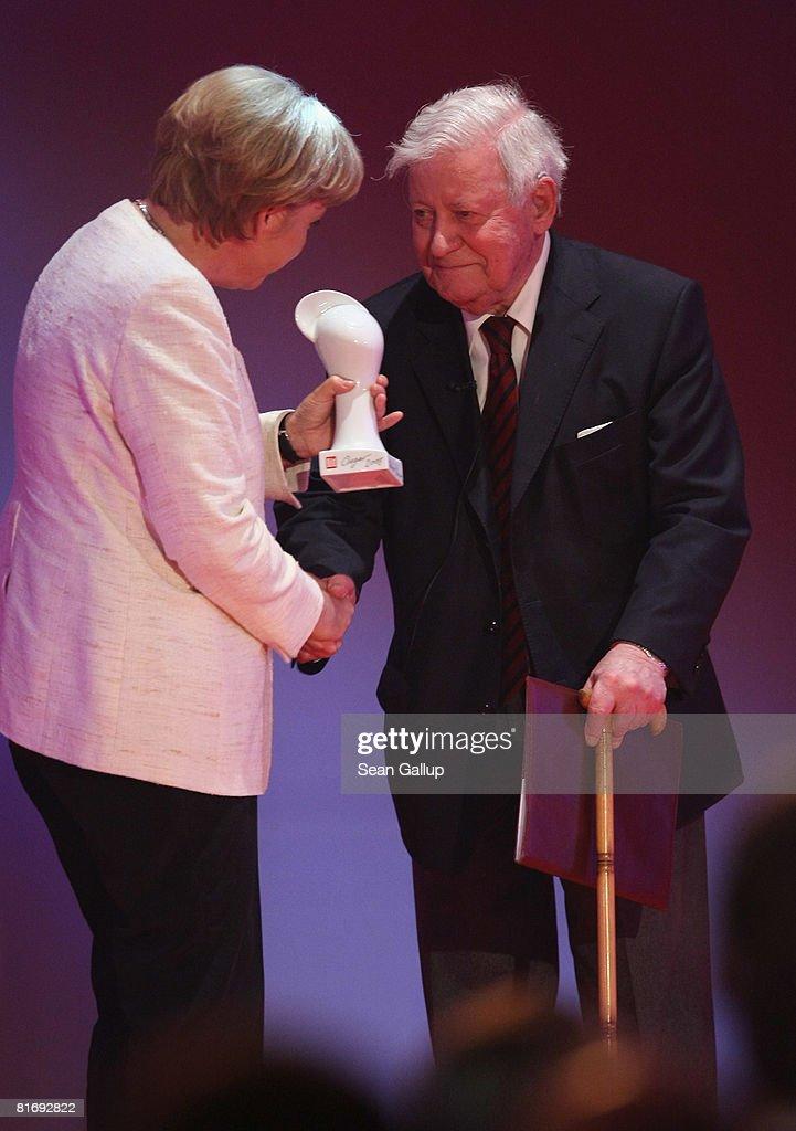 German Chancellor Angela Merkel gives former Chancellor Helmut Schmidt the Bild OSGAR Award at the Bild OSGAR Award at City Hall on June 24, 2008 in Leipzig, Germany.