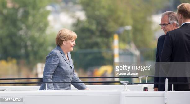 German Chancellor Angela Merkel goes on at the military part of the airport Berlin Tegel to the Airbus A340 of the German Air Force in Berlin Germany...