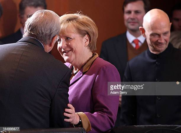 German Chancellor Angela Merkel greets Angel Gurria secretarygeneral of the Organisation for Economic Cooperation and Development next to Pascal Lamy...