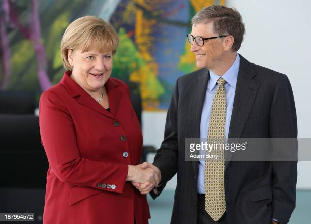 German Chancellor Angela Merkel greets Bill Gates, co-founder of the Bill & Melinda Gates Foundation and former head of Microsoft, at the German...