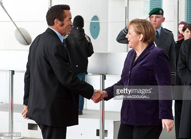 German Chancellor Angela Merkel greets Botswana's President Seretse Khama Ian Khama prior to talks at the chancellery in Berlin on February 7 2012...