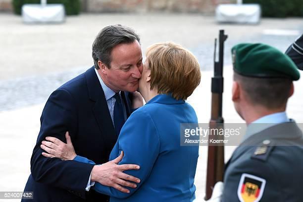 German Chancellor Angela Merkel greets British Prime Minister David Cameron at Schloss Herrenhausen palace upon his arrival for a meeting between US...