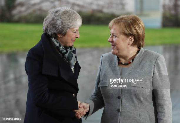 German Chancellor Angela Merkel greets British Prime Minister Theresa May upon May's arrival for talks at the Chancellery on December 11 2018 in...