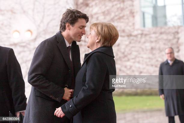 German Chancellor Angela Merkel greets Canada's Prime Minister Justin Trudeau upon his arrival at the Chancellery in Berlin Germany on February 17...