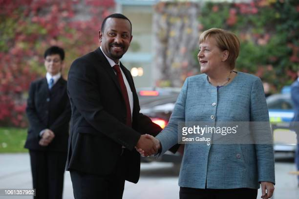 "German Chancellor Angela Merkel greets Ethiopian Prime Minister Abiy Ahmed at the Chancellery during the ""Compact with Africa"" conference on October..."