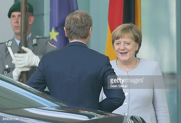 German Chancellor Angela Merkel greets European Council President Donald Tusk upon his arrival four days after the Brexit vote was confirmed in the...