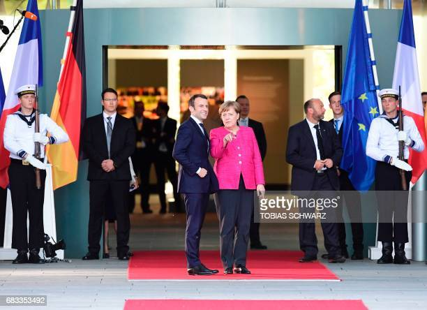 German Chancellor Angela Merkel greets French President Emmanuel Macron prior talks on May 15, 2017 at the chancellery in Berlin, one day after the...