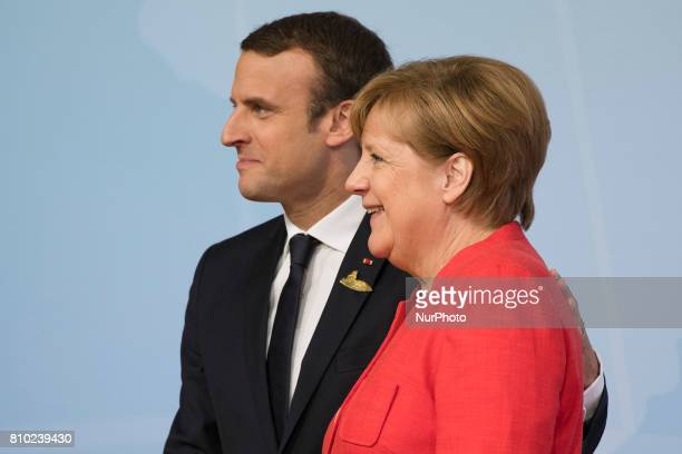 German Chancellor Angela Merkel greets French President Emmanuel Macron upon his arrival at the G20 meeting in Hamburg Germany on July 7 2017