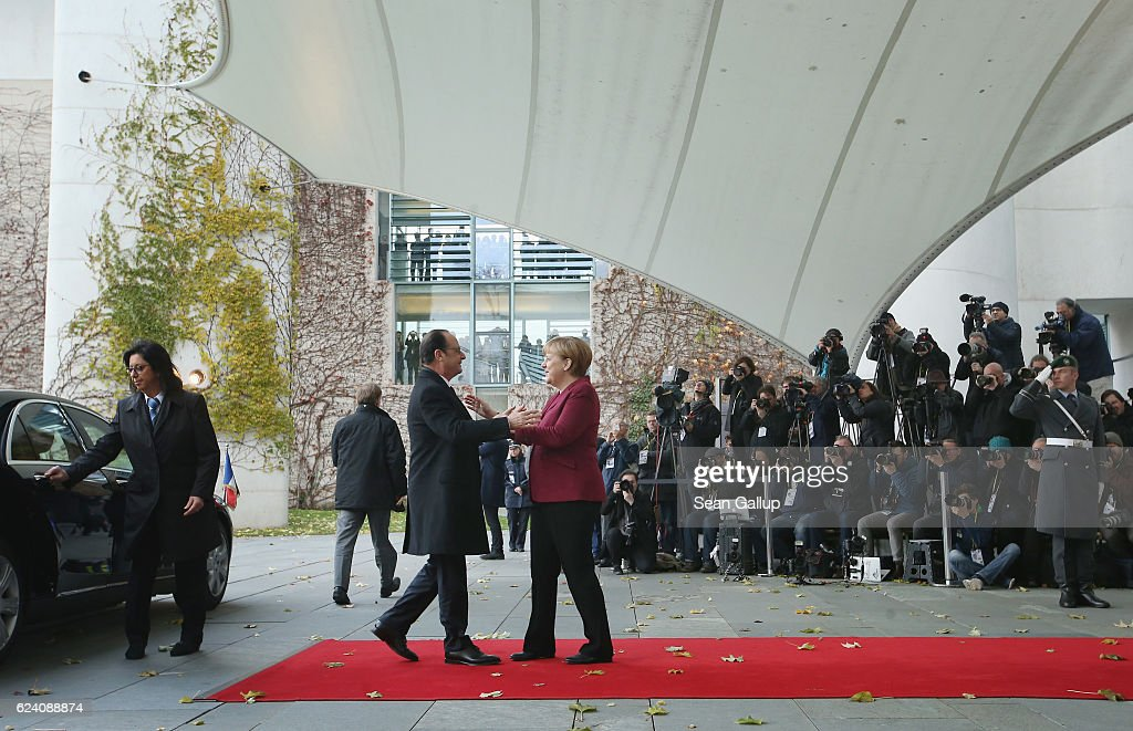 German Chancellor Angela Merkel greets French President Francois Hollande upon his arrival for talks between U.S. President Barack Obama and western European leaders at the Chancellery on November 18, 2016 in Berlin, Germany. Obama and Merkel will hold talks with British Prime Minister Theresa May, French President Francois Hollande, Italian Prime Minister Matteo Renzi and Spanish Prime Minister Mariano Rajoy today on Obama's last trip to Europe as U.S. President.