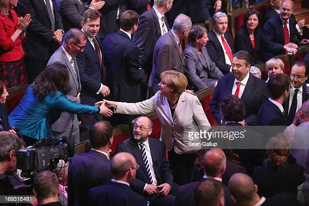 German Chancellor Angela Merkel greets German Social Democrats DeputyChairwoman Andrea Nahles as SPD Chairman Sigmar Gabriel looks on at the 150th...