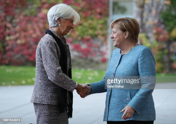 German Chancellor Angela Merkel greets International Monetary Fund head Christine Lagarde at the Chancellery during the 'Compact with Africa'...