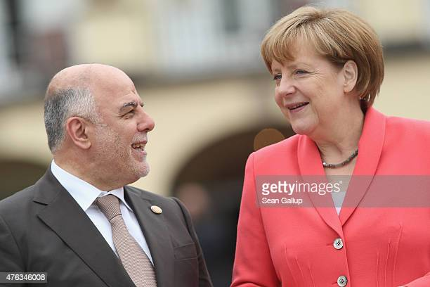 German Chancellor Angela Merkel greets Iraqi Prime Minister Haider alAbadi on the second day of the summit of G7 nations at Schloss Elmau on June 8...