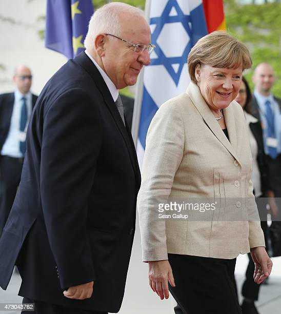 German Chancellor Angela Merkel greets Israeli President Reuven Rivlin upon Rivlin's arrival at the Chancellery on the third day of his visit to...