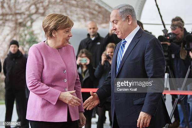 German Chancellor Angela Merkel greets Israeli Prime Minister Benjamin Netanyahu upon his arrival at the Chancellery for the 6th GermanIsraeli...