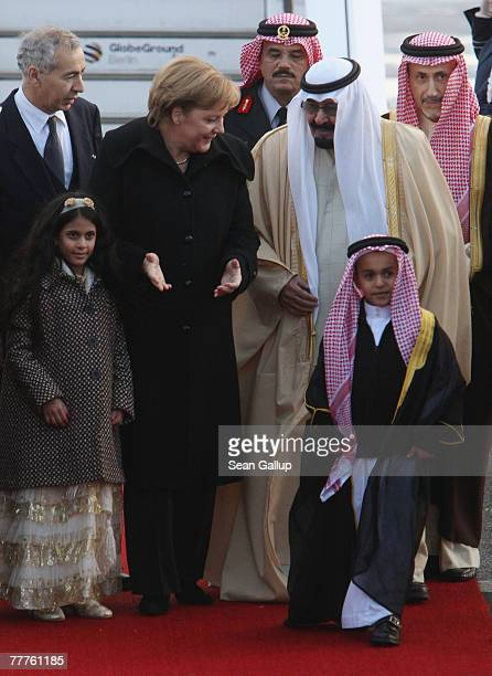 German Chancellor Angela Merkel greets King Abdullah of Saudi Arabia and children of an employee of the saudi embassy in Germany upon the Kings...