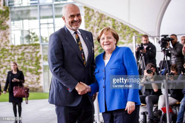 German Chancellor Angela Merkel greets Kosovo Prime Minister Ramush Haradina upon his arrival at the Chancellery for a conference on western Balkan...