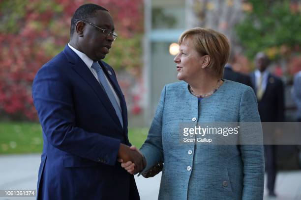 German Chancellor Angela Merkel greets Macky Sall President of Senegal at the Chancellery during the Compact with Africa conference on October 30...