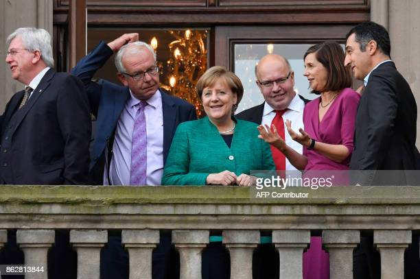 German Chancellor Angela Merkel greets members of the leadership of the Green party including Katrin GoeringEckardt and Cem Ozdemir with her...