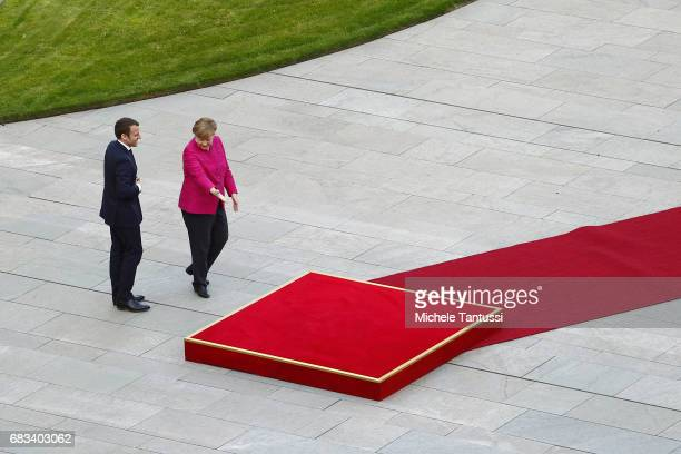 German Chancellor Angela Merkel greets newlyelected French President Emmanuel Macron at the Chancellery on May 15 2017 in Berlin Germany Macron is...