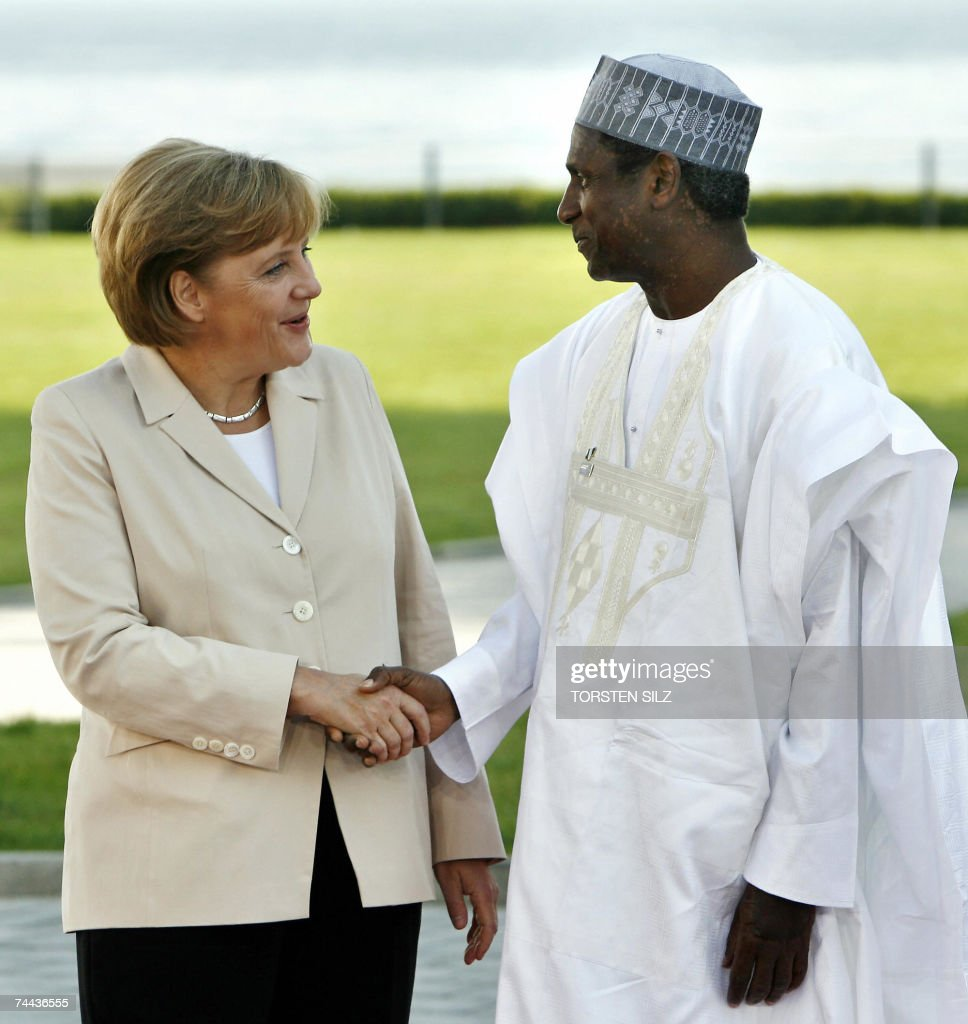 German Chancellor Angela Merkel greets Nigerian President Umaru Yar'Adua 08 June 2007 on the last day of the G8 summit in Heiligendamm, northeastern Germany. African leaders are attending the summit to meet the Group of Eight leaders. The Group of Eight wealthiest nations agreed to pledge 60 billion dollars to fight AIDS and malaria in Africa