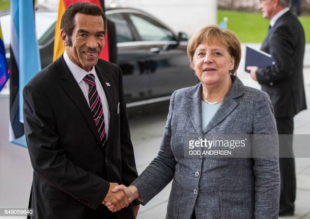 German Chancellor Angela Merkel greets President Ian Khama of Botswana on his arrival for a meeting at the Chencellery in Berlin on March 7 2017 /...