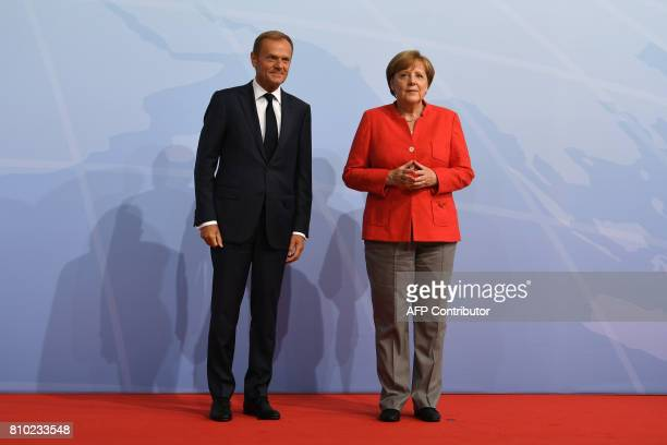 German Chancellor Angela Merkel greets President of the European Council Donald Tusk prior to the start of the first working session of the G20...