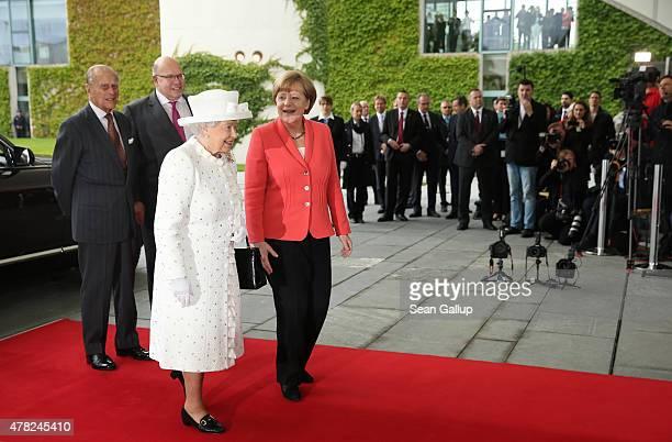 German Chancellor Angela Merkel greets Queen Elizabeth II as Prince Philip Duke of Edinburgh and Chief of Staff of the German Chancellery Peter...