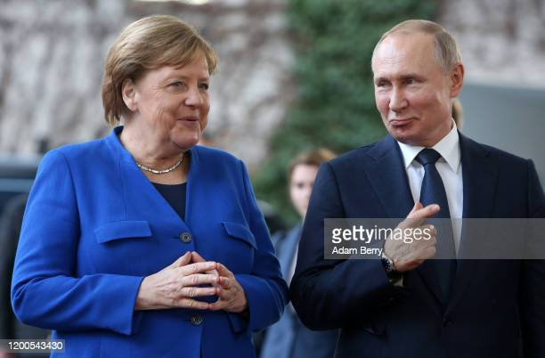 German Chancellor Angela Merkel greets Russian President Vladimir Putin as he arrives for an international summit on securing peace in Libya at the...
