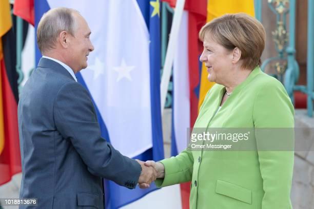 German Chancellor Angela Merkel greets Russian President Vladimir Putin upon his arrival at Schloss Meseberg palace the German government retreat at...