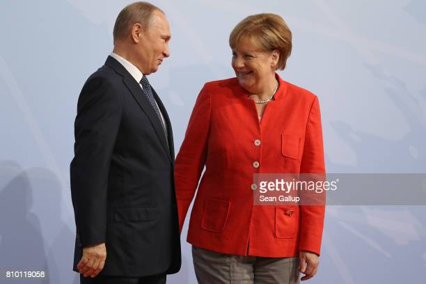 German Chancellor Angela Merkel greets Russian President Vladimir Putin upon his arrival for the first day of the G20 economic summit on July 7 2017...