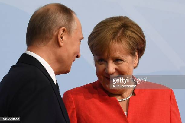 German Chancellor Angela Merkel greets Russia's President Vladimir Putin prior to the start of the first working session of the G20 meeting in...