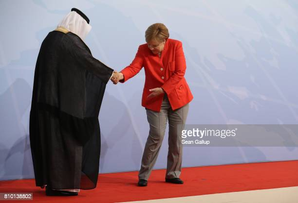 German Chancellor Angela Merkel greets Saudi Arabian State Minister Ibrahim Abdulaziz AlAssaf upon his arrival for the first day of the G20 economic...