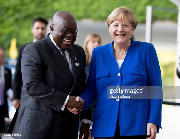 German chancellor Angela Merkel greets the president of Ghana Nana AkufoAddo outside the federal chancellery during the G20 Africa Partnership...