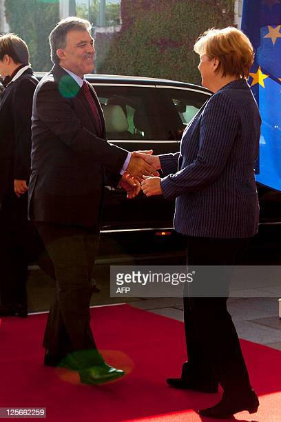 German Chancellor Angela Merkel greets Turkey's President Abdullah Gul as he arrives for a meeting at the Chancellery in Berlin on September 20 ,...
