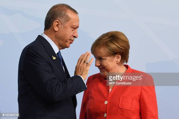 German Chancellor Angela Merkel greets Turkey's President Recep Tayyip Erdogan prior to the start of the first working session of the G20 meeting in...