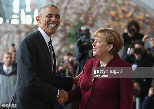 German Chancellor Angela Merkel greets US President Barack Obama upon his arrival for talks with European leaders at the Chancellery on November 18...