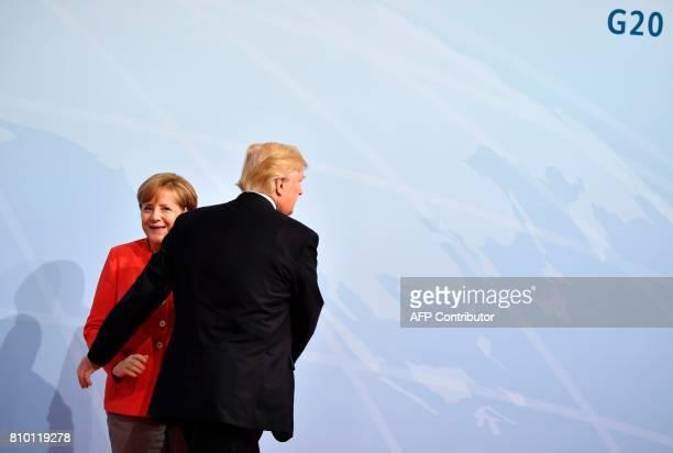 TOPSHOT German Chancellor Angela Merkel greets US President Donald Trump at the start of the G20 meeting in Hamburg northern Germany on July 7...