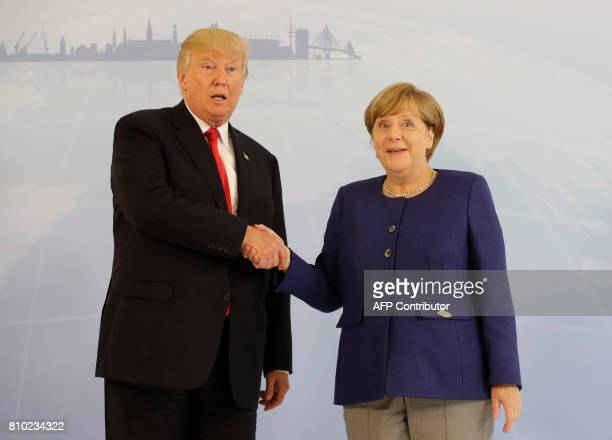 German Chancellor Angela Merkel greets US President Donald Trump prior to the start of the first working session of the G20 meeting in Hamburg...