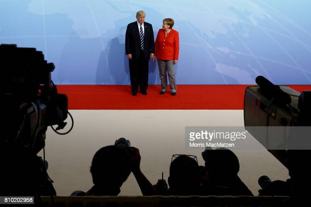German Chancellor Angela Merkel greets US President Donald Trump upon his arrival for the first day of the G20 economic summit on July 7 2017 in...