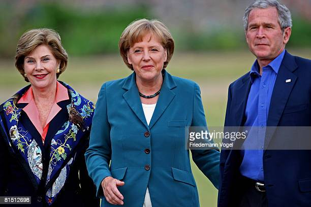German Chancellor Angela Merkel greets US President George W Bush and his wife Laura Bush upon their arrival at Schloss Meseberg Palace on June 10...