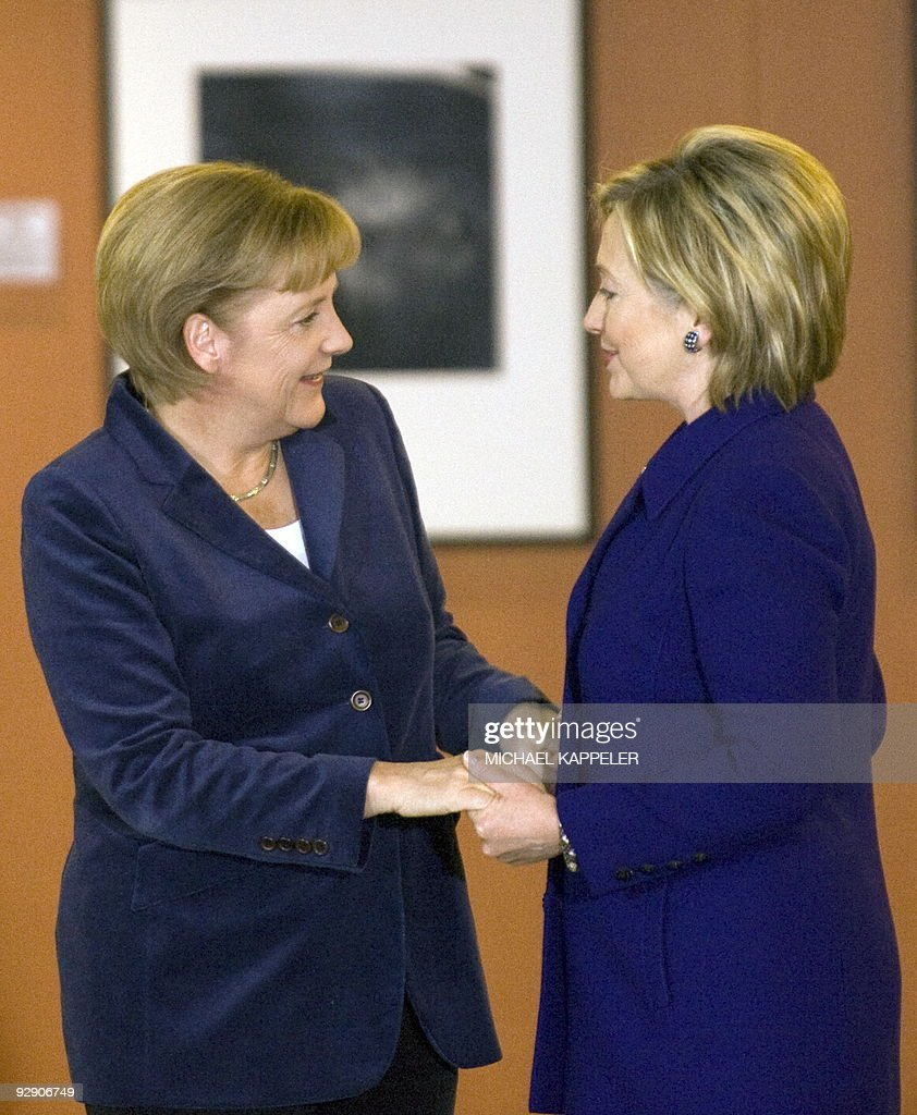 German Chancellor Angela Merkel (L) greets US Secretary of State Hillary Clinton prior to bilateral talks on November 9, 2009 at the Chancellory in Berlin, ahead of celebrations for the 20th anniversary of the fall of the wall.