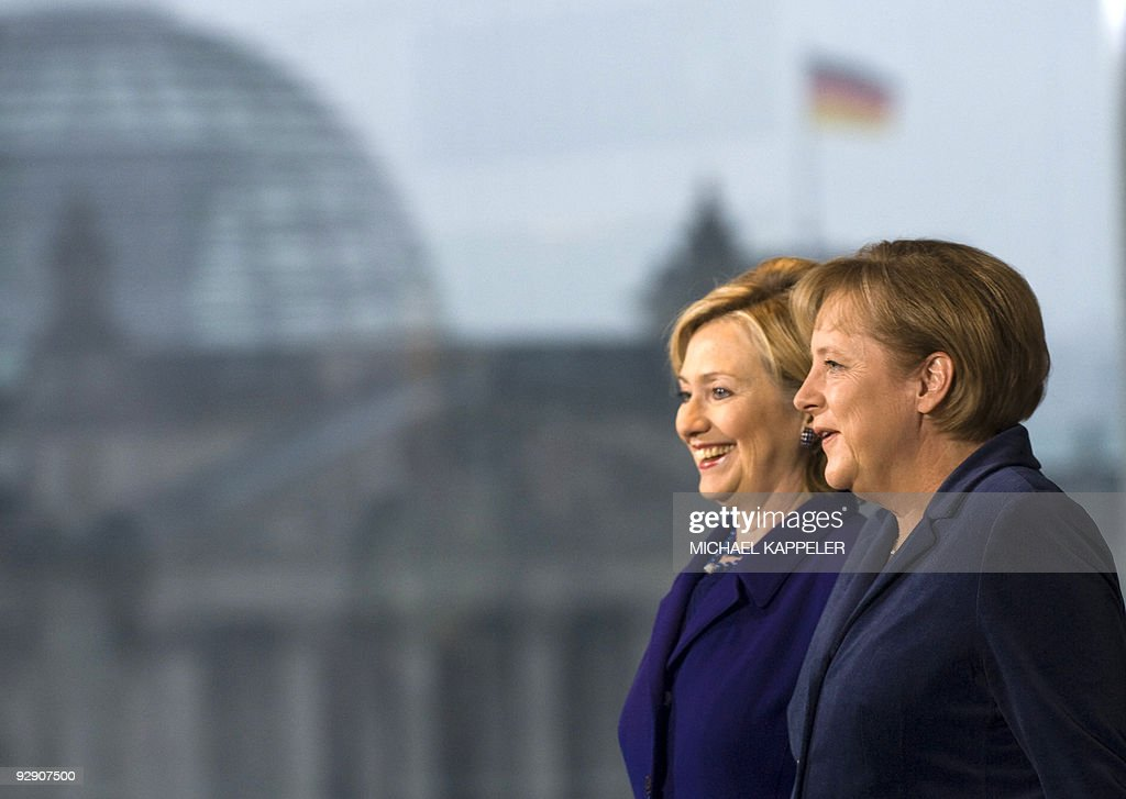 German Chancellor Angela Merkel (L) greets US Secretary of State Hillary Clinton prior to bilateral talks on November 9, 2009 at the Chancellory in Berlin, ahead of celebrations for the 20th anniversary of the fall of the wall. Behind is seen the Reichstag building.