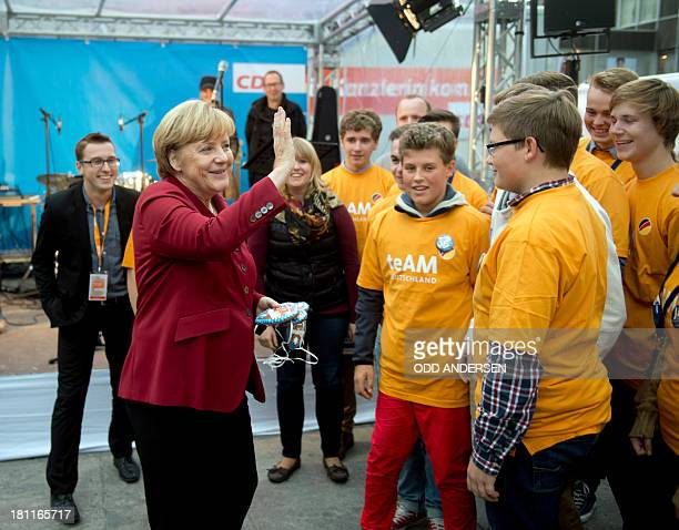 German Chancellor Angela Merkel greets volunteers at an election campaign event of her German Christian Democratic Union party in the central German...