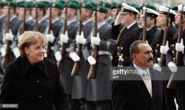 German Chancellor Angela Merkel greets Yemeni President Ali Abdullah Saleh with military honours on February 27 2008 in the courtyard of the...